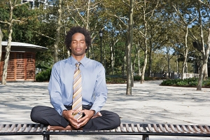 bigstock-man-meditating-in-a-park-is-20541419